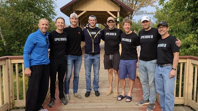The Epic Ride team is pictured Monday. The West Michigan based group includes, not pictured in order: Ben Blake, Ralph Buckingham, Nick DeHaan, Joseph Lampen, Sean Murphy, Jon Ornée, Jeremy Sall and Justin Van Beek.
