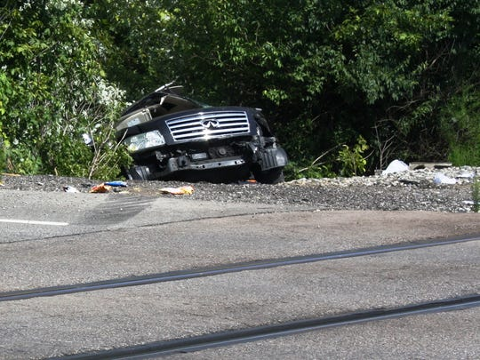 One man was taken to the hospital after his vehicle was hit by a train and pushed into a wooded area near the road.