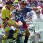 Romania's Dorinel Ionel Munteanu, left, and United States' Paul Caligiuri battle for the ball during the first half of the Group A first-round World Cup match at the Rose Bowl in Pasadena, Calif., Sunday, June 26, 1994.