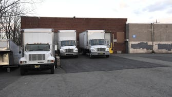 Delivery trucks sit behind a warehouse on Federal street in Clifton, NJ on Friday, December 9, 2016. The traffic in and out of the warehouse delivery bays have caused problems in the neighborhood.