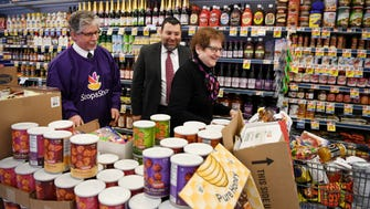(from left) Joe Gondek, Store Manager at Stop and Shop in Teaneck, Rabbi Chaim Poupko, President of the Rabbinical Council of Bergen County, and Mollie Fisch, a Teaneck resident, in an aisle at Stop and Shop in Teaneck featuring an assortment of Kosher food on Wednesday, March 14, 2018.