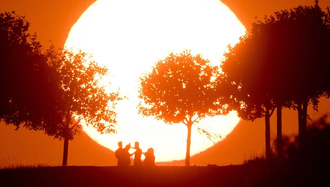 The sun sets on the horizon in Hanover, Germany, on Sept. 12, 2016. Europe had its warmest September on record.