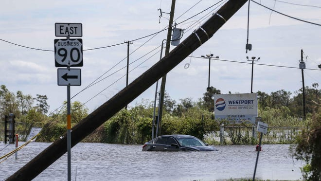 A car submerged in a flood on Pier Rd after Hurricane Laura hit the area overnight in Orange on Thursday, August 27, 2020.