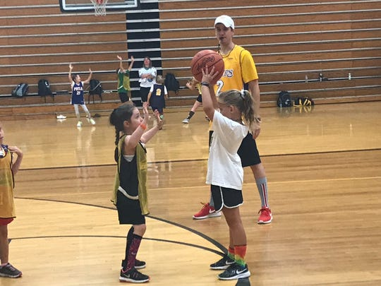 New Watkins Memorial coach Tate Moore runs his youth