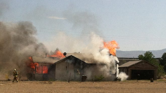 A fire destroyed a home off U.S. 95A in Fernley Sunday, and the cause remains under investigation.
