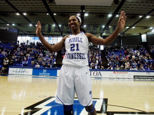 MTSU's Ebony Rowe reacts to the cheers of the crowd after scoring her 2149th point to become the all time leading scorer in MTSU women's basketball at MTSU Saturday, Jan. 25, 2014.