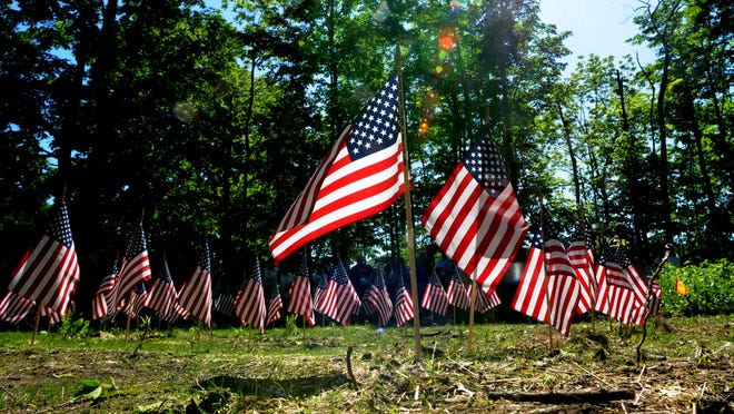 Flags appeared at the Fishkill Burial Grounds, a largely unmarked revolutionary war burial ground near Van Wyck Homestead Museum for a Memorial Day ceremony last year, in Fishkill.