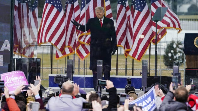 President Donald Trump arrives to speak at a rally Wednesday in Washington. The Adrian Dominican Sisters General Council has called for Trump to be removed from office.