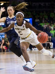 Notre Dame's Jackie Young, right, drives by Villanova's