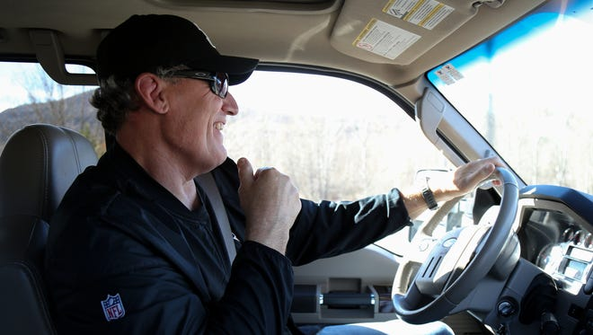 Former Cincinnati Bengals defensive tackle Tim Krumrie, pictured driving around Steamboat Springs, Colorado, suffers from a damaged frontal lobe in his brain, but he has sought treatment that he now says has improved his health. He played 12 seasons in the NFL.