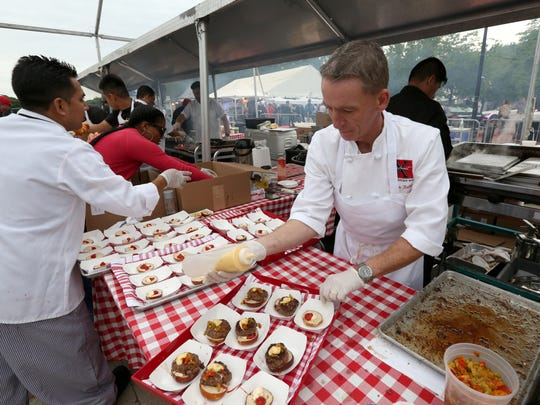 James Kelly of Restaurant X in Congers prepares burgers at the Burger & Beer Blast at the Kensico Dam Plaza in Valhalla, part of the Westchester Wine & Food Festival.