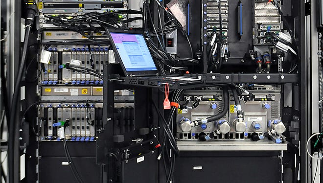 This photo shows the internal components of an IBM zEnterprise EC12 server.