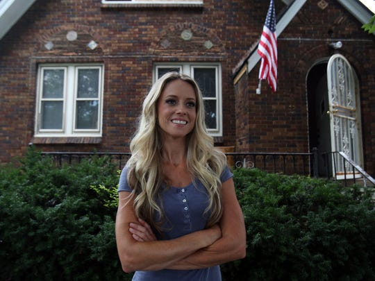 Nicole Curtis of Rehab Addict on the DIY Network in front of the Detroit home on Tuesday, July 23, 2013, that she is rehabbing for her show.