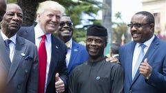 From left, Guinea's President Alpha Conde, U.S. President