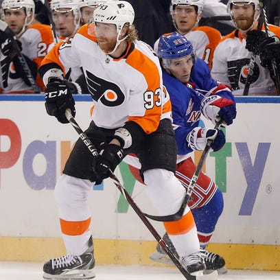 Philadelphia Flyers right wing Jakub Voracek (93) controls the puck against New York Rangers center Vinni Lettieri (95) during the first period of an NHL hockey game, Tuesday, Jan. 16, 2018, in New York. (AP Photo/Julie Jacobson)