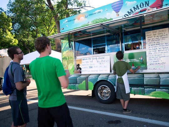 People wait for food at the Common Link food truck at day one of 18th annual Taste of Fort Collins at Civic Center Park on June 13, 2014.