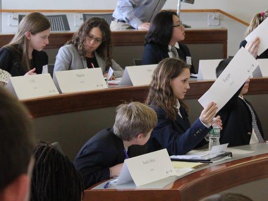 Dutchess Day School seventh-grader Danielle Page raises