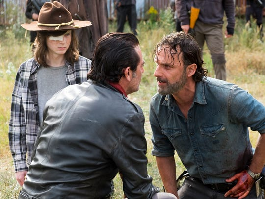 Enemies Negan (Jeffrey Dean Morgan), center, and Rick,