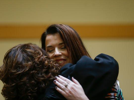 Judge Sarah Weaver hugs New Mexico Court of Appeals