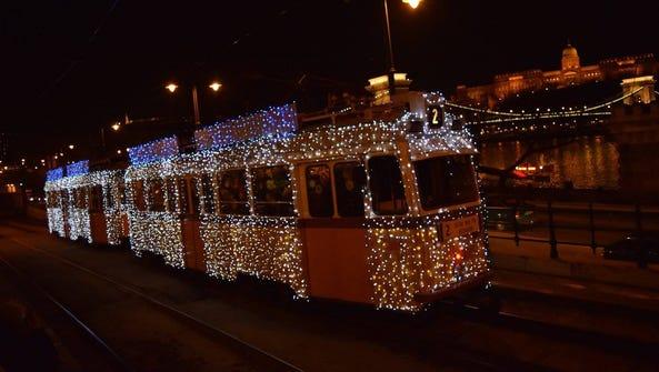 Budapest's Christmas Tram arrives along the Danube
