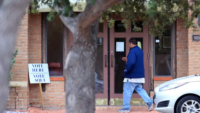 A voter heads into Grace Presbyterian Church on Tuesday, Nov. 8, 2016.