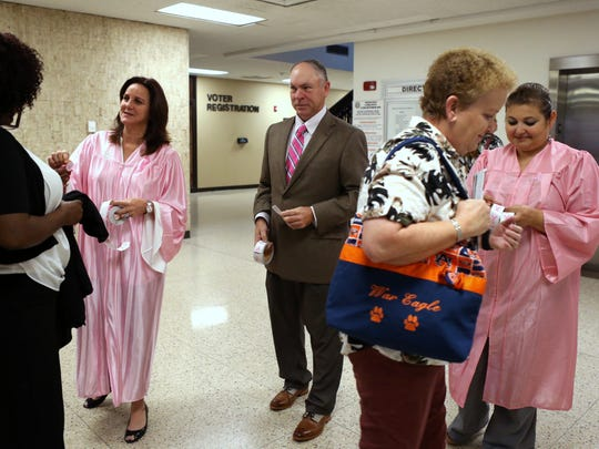 347th District Court Judge Missy Medary (from left), 105th District Court Judge Jack Pulcher and 214th District Court Judge Inna Klein hand out breast cancer awareness stickers as people arrive for jury duty at the Nueces County Courthouse on Monday, October 2, 2017. Judges hand out stickers and remind people arriving at the courthouse on Monday mornings in October about the need to get a mammogram and to remind their loved ones as well.