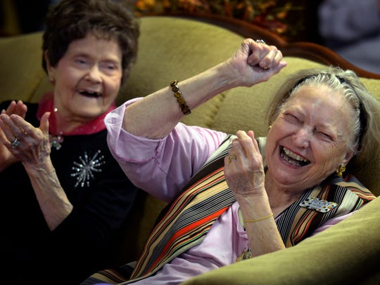 Martha Farmen, 91, right, and Becky Avril, 87, cheer