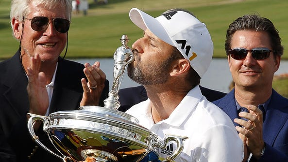 Sergio Garcia kisses the championship trophy after