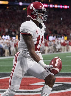 Alabama wide receiver Henry Ruggs III (11) scores a touchdown against Georgia in second half action of the College Football Playoff National Championship Game in the Mercedes Benz Stadium in Atlanta, Ga., on Monday January 8, 2018.