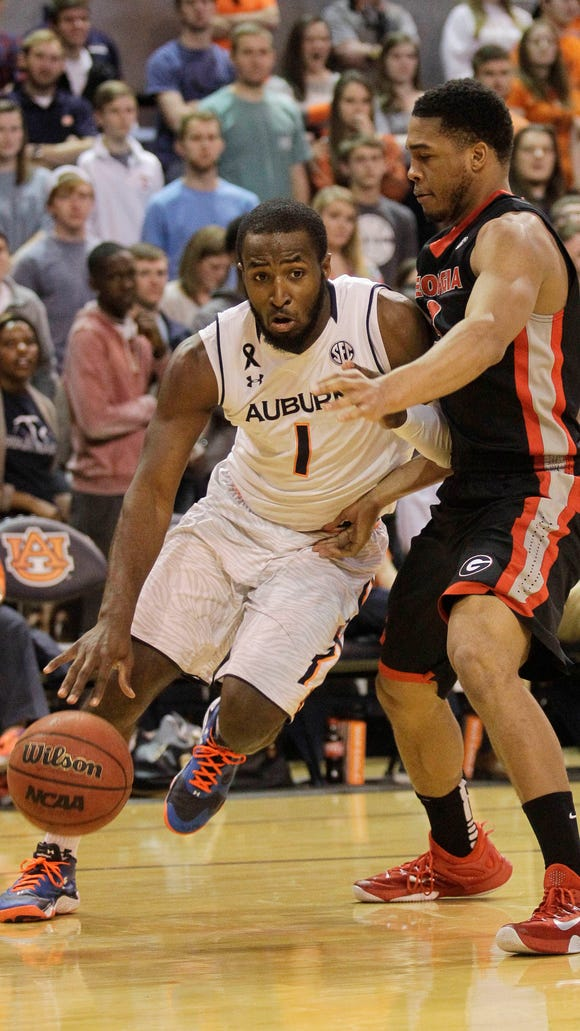 Auburn Tigers guard KT Harrell (1) is blocked by Georgia Bulldogs guard Juwan Parker (3) during the second half at Auburn Arena.  The Bulldogs beat the Tigers 64-61. Mandatory Credit: John Reed-USA TODAY Sports