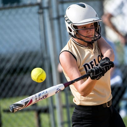 Delone Catholic's Maria Schussler swings into a pitch,