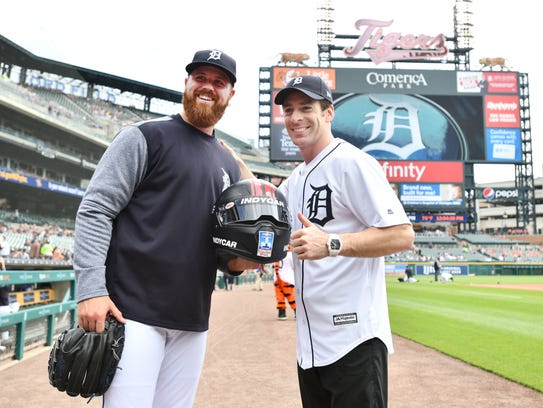 Detroit Tigers pitcher Buck Farmer, left, and IndyCar