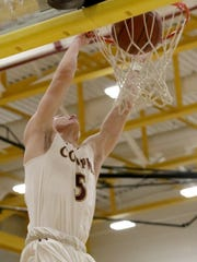 Cooper 's Adam Kunkel dunks the ball during the Jaguars