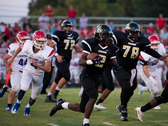 Donta' Mayberry runs with the ball during Kenwood's