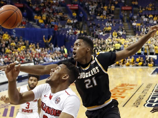 linois State's DJ Clayton and Wichita State's Darral Willis Jr. (21) reach for a rebound during the first half of an NCAA college basketball game in the championship of the Missouri Valley Conference men's tournament Sunday, March 5, 2017, in St. Louis.
