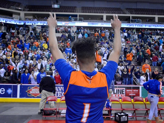 York High's Kyree Generett celebrates with Bearcats fans after defeating Northeastern, 84-80, in overtime of Monday's District 3 Class 5-A semifinal at Hershey's Giant Center. John A. Pavoncello