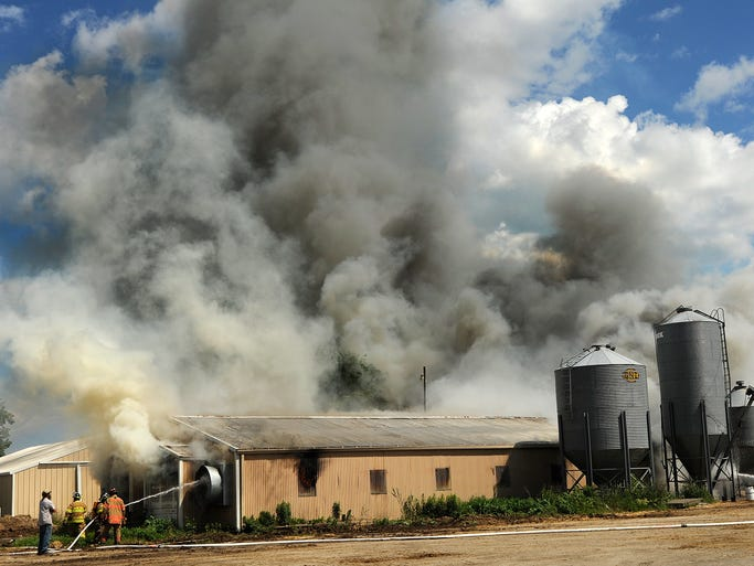 Firefighters battle a barn fire on Wednesday, July 9, 2014 in Centerville. More than 12 fire engines responded, some including Haven, Newton, St. Nazianz, Ada, Howards Grove, Valders, and more. Matthew Apgar/HTR Media