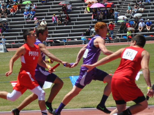 Christian Najar hands off to Dillon Najar in the boys 4 x 200 relay.The team earned second with a time of 4:05.24.