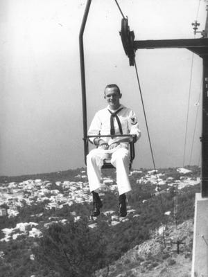 Benny Hornsby takes a chairlift up Monte Solaro on the Isle of Capri, circa 1961.