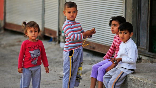 Syrian refugee children pass time in a neighborhood of the city of Gaziantep in southeastern Turkey earlier this year.