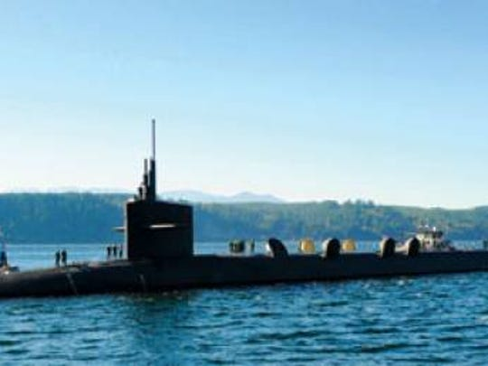 The Ohio-class ballistic submarine USS Alabama returns to Naval Base Kitsap from a deterrent patrol. The Alabama is one of 14 Ohio-class submarines, which are armed with the W88 nuclear warhead.
