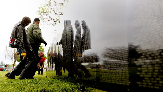 """Volunteers work to piece together the Vietnam Traveling Memorial Wall, known as """"The Wall that Heals,"""" in York City, Wednesday, May 4, 2016. The wall will be on display at the York Fairgrounds May 5-8. Dawn J. Sagert  photo"""