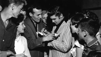 Elvis Presley and Carl Perkins swapped autographs on the night of June 1, 1956, as their paths crossed at the Overton Park Shell. Some 5,000 teenagers turned out that night for two hours of rock and roll by various artists including Perkins. Elvis made a surprise appearance at the show.