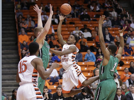 UTEP's Omega Harris drives to the hoop on Thursday