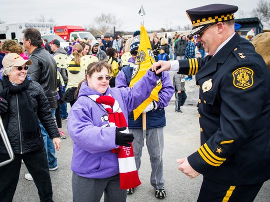 Special Olympics athlete Jenny Laudeman dances with Pittsburgh Police Department Cmdr. Scott Schubert during the seventh annual Special Olympics York County Polar Plunge in Wrightsville on Saturday. Schubert is on the Special Olympics Pennsylvania board of directors.