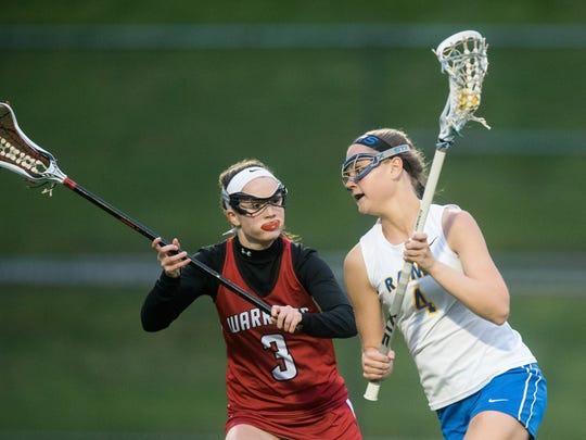 Kennard-Dale's Morgan Bowing (4) carries the ball on attack against Susquehannock's Riley Roeder (3) in a YAIAA girls' lacrosse game on Thursday, May 5, 2016. Kennard-Dale won 17-6 to take second place in the league.