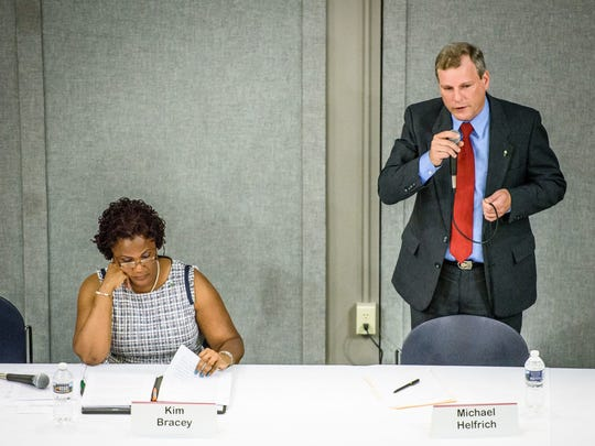 """York Mayor Kim Bracey and York City Council president and mayoral candidate Michael Helfrich spoke at a debate on May 1. Helfrich is taking issue with Bracey saying she wants to hire """"eight more, new officers"""" to the city's police department."""