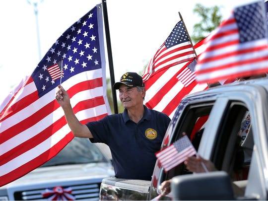Al Borrego Sr. rides in the San Elizario veterans float Tuesday in the People's 4th of July Parade in east El Paso.