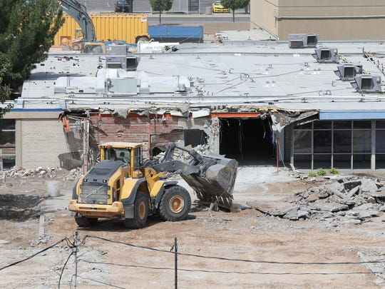 A bulldozer clears out what remains of Eastwood High School on Wednesday.