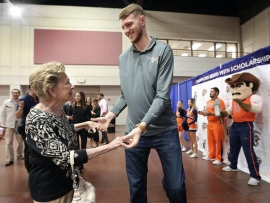 UTEP's 7-foot-1 center Matt Willms greets Mary Haskins